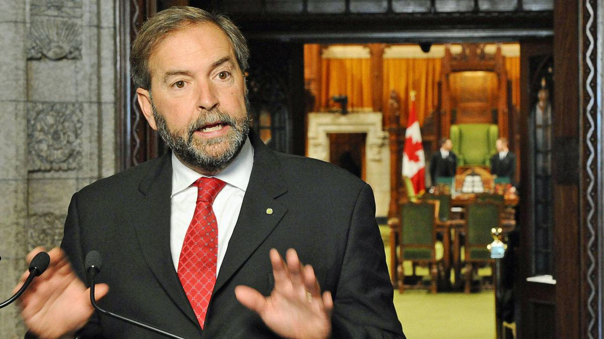 Opposition House Leader Thomas Mulcair speaks to reporters in the foyer of the House of Commons on Sept. 27, 2011.