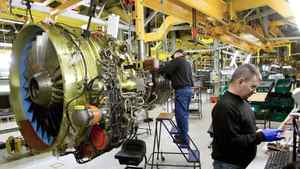 Technicians assemble a General Electric CFM56-7B jet engine at the company's facility in Durham, N.C.