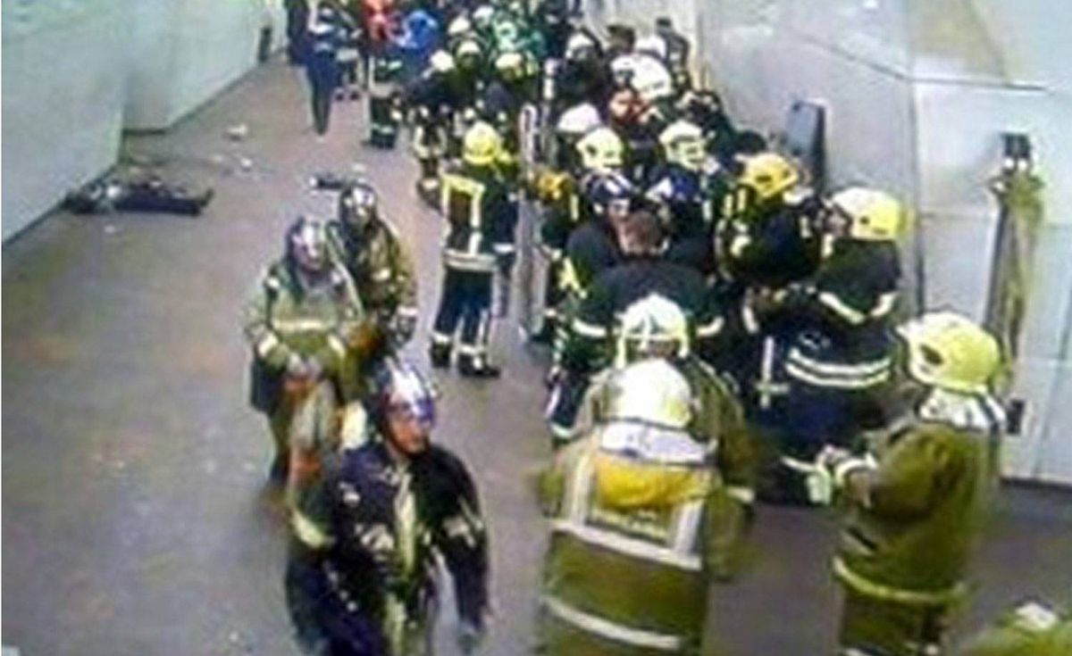 An image from a security camera at Lubyanka metro station, shows firefighters attending the scene following an explosion in Moscow.