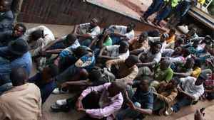 """A group of 46 social and human rights activists appear in court in Harare, Wednesday, Feb. 23, 2011. The group led by Munyaradzi Gwisai is alleged to have organized a meeting where they played video footage of the Egypt uprising allegedly """"to inspire and motivate people to demonstrate against the government"""". Police say attendees called for solidarity with Egyptian and Tunisian workers and intended to incite Zimbabweans to hold demonstrations against three decades of authoritarian rule by President Robert Mugabe"""
