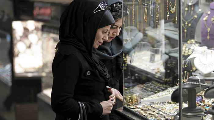Women look at jewellery at a shop window in a bazaar in northern Tehran. For months, Iranians have endured economic hardship, political repression and international isolation as the authorities refuse to halt sensitive nuclear work as demanded by the UN Security Council.