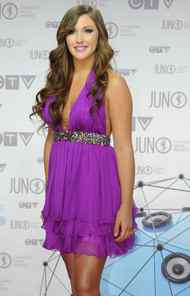 Alyssa Reid poses for photographers as she arrives on the red carpet at the Juno Awards in Ottawa, Sunday April 1, 2012.