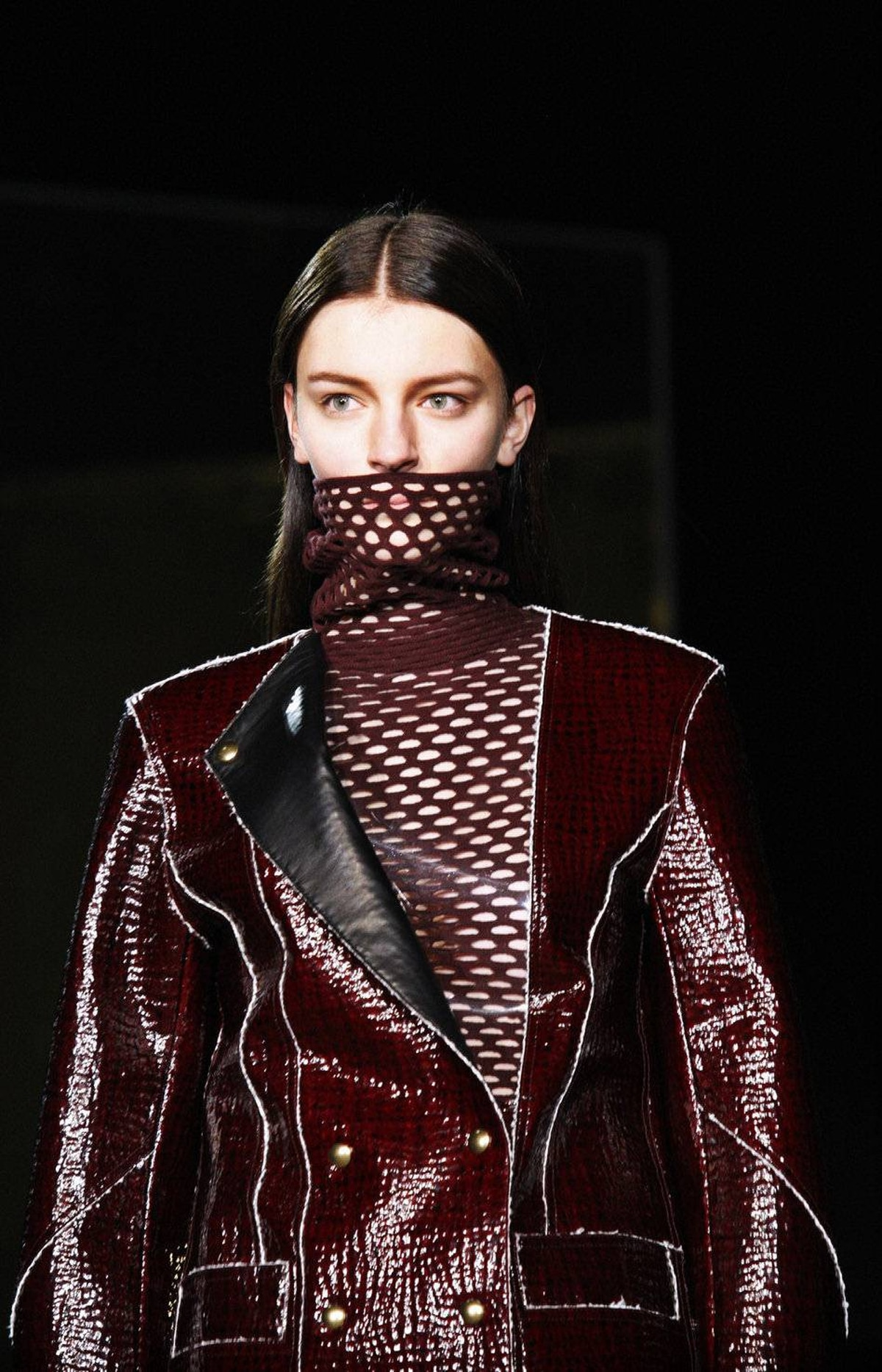 Alexander Wang's ominously tinged show kicked off with models wearing thick mesh masks over their mouths. But mirrored frames, staged at angles throughout a dark warehouse, did little to improve the visibility so fabric details such as this interesting ribbed, lacquered merino wool were difficult to discern.