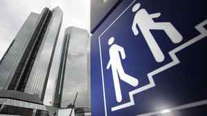 The headquarters of Deutsche Bank are pictured next to a pictograph in Frankfurt July 23, 2010.