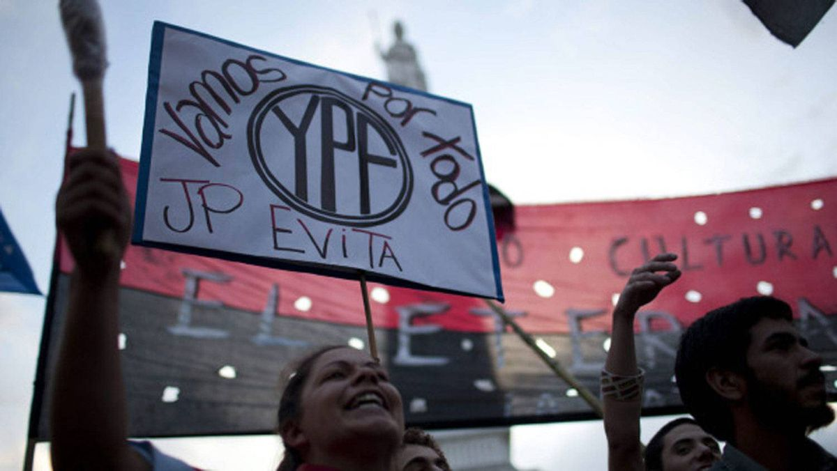 Demonstrators in Buenos Aires on Monday hold up a banner that reads in Spanish 'We are going for all YPF,' in support of a bill proposed by Argentina's President Cristina Fernandez to expropriate 51 per cent of the shares of YPF oil company that is controlled by Spain's Repsol.
