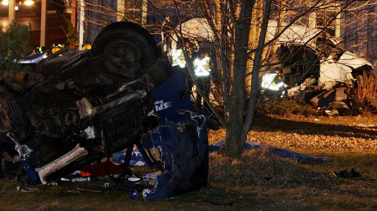 Ontario Provincial Police and emergency crews investigate a multiple fatal motor vehicle accident near Hampstead, Ont.,Feb. 6, 2012. Police say 11 people died in the crash.