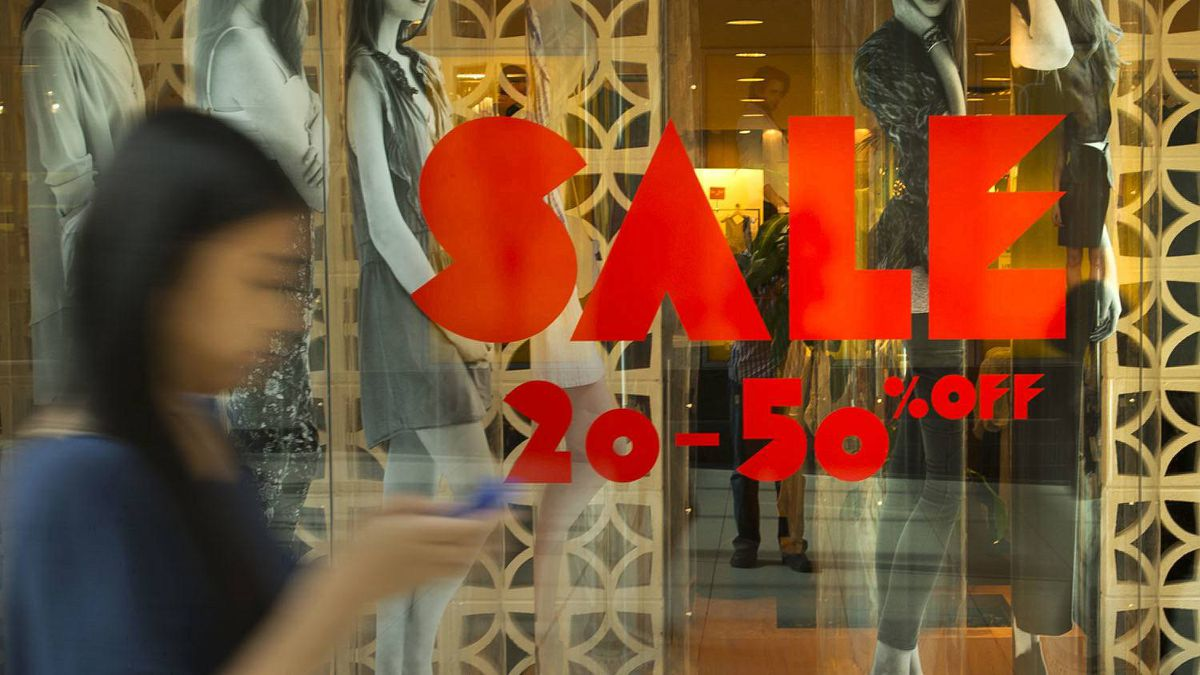 A sale sign is seen at Aritzia at the Eaton Centre in Toronto, Ont.