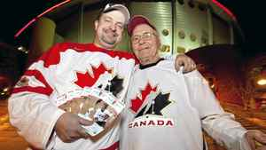 Jermey Vander Maaten and his 86-year-old grandfather Herbert Cross show some of their tickets for the world junior tournament. Vander Maaten paid more than $3000 for tickets to all the games that take place in Calgary.