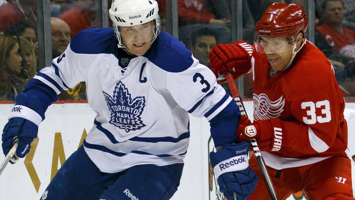 Detroit Red Wings right wing Kris Draper (33) chases Toronto Maple Leafs defenseman Dion Phaneuf (3) around the net in the second period of an NHL hockey game in Detroit, Saturday, March 26, 2011. (AP Photo/Rick Osentoski)