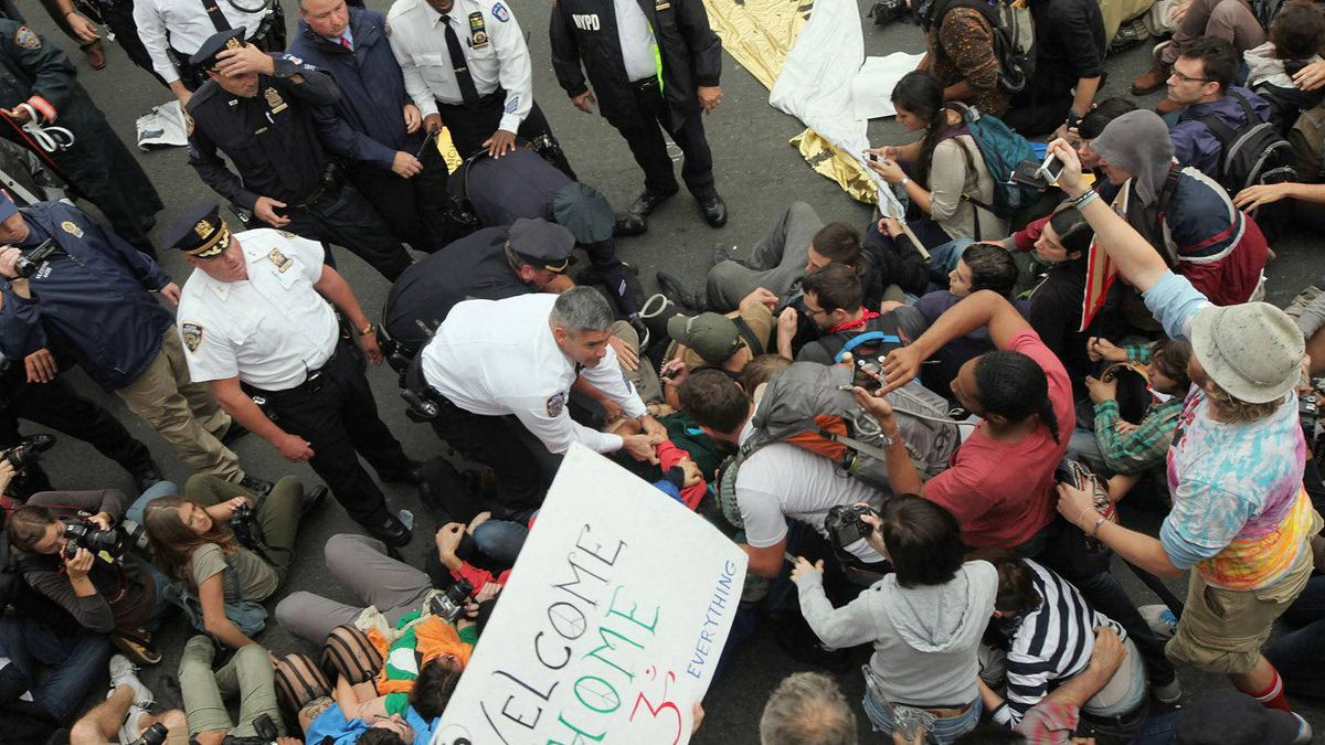 Police begin arresting members of the Occupy Wall Street protests after they crossed on to portions of the Brooklyn Bridge not meant for pedestrians.