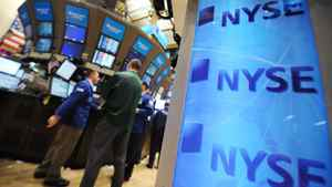 This April 18, 2011 file photo shows traders as they work at their posts on the floor of the New York Stock Exchange.