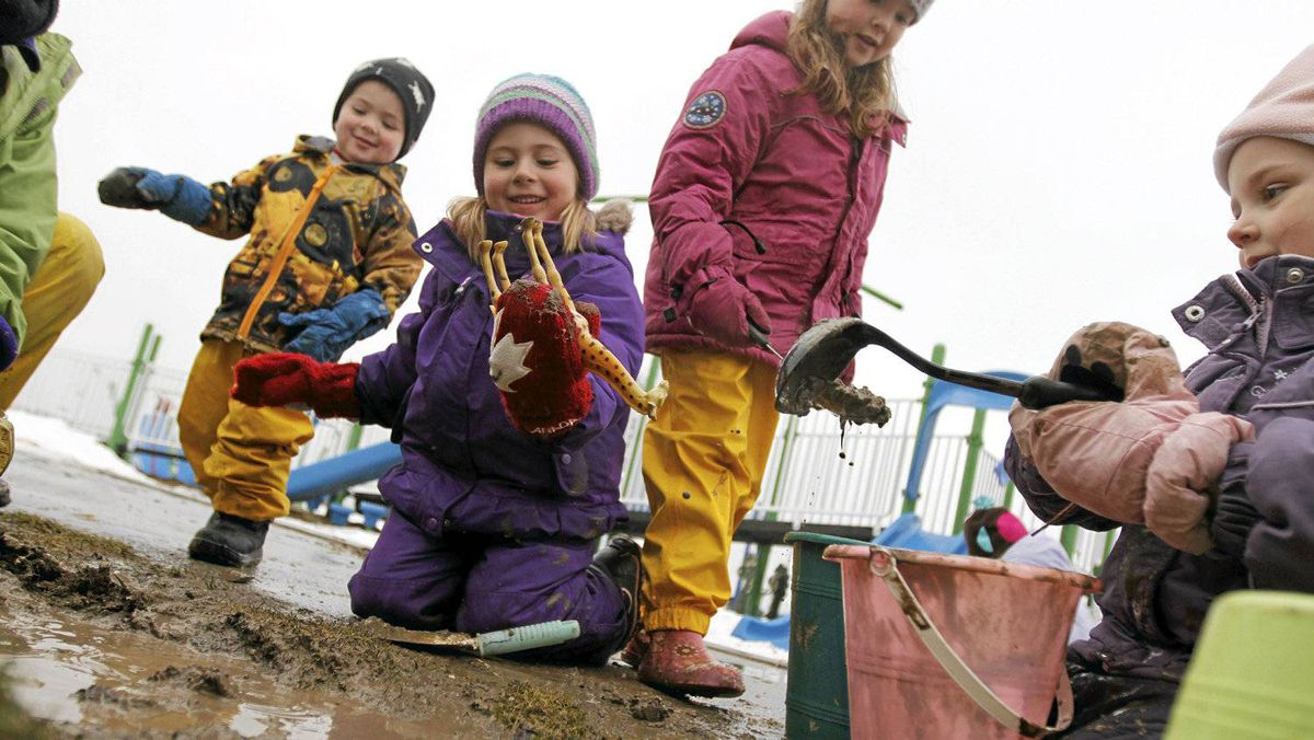 Jack Maxwell, 3; Grace Syms, 4; Lily Maxwell, 5; and Sydney Richardson, 3, dig up the playground at Spencer Smith Park in Bulrlington, Ont.