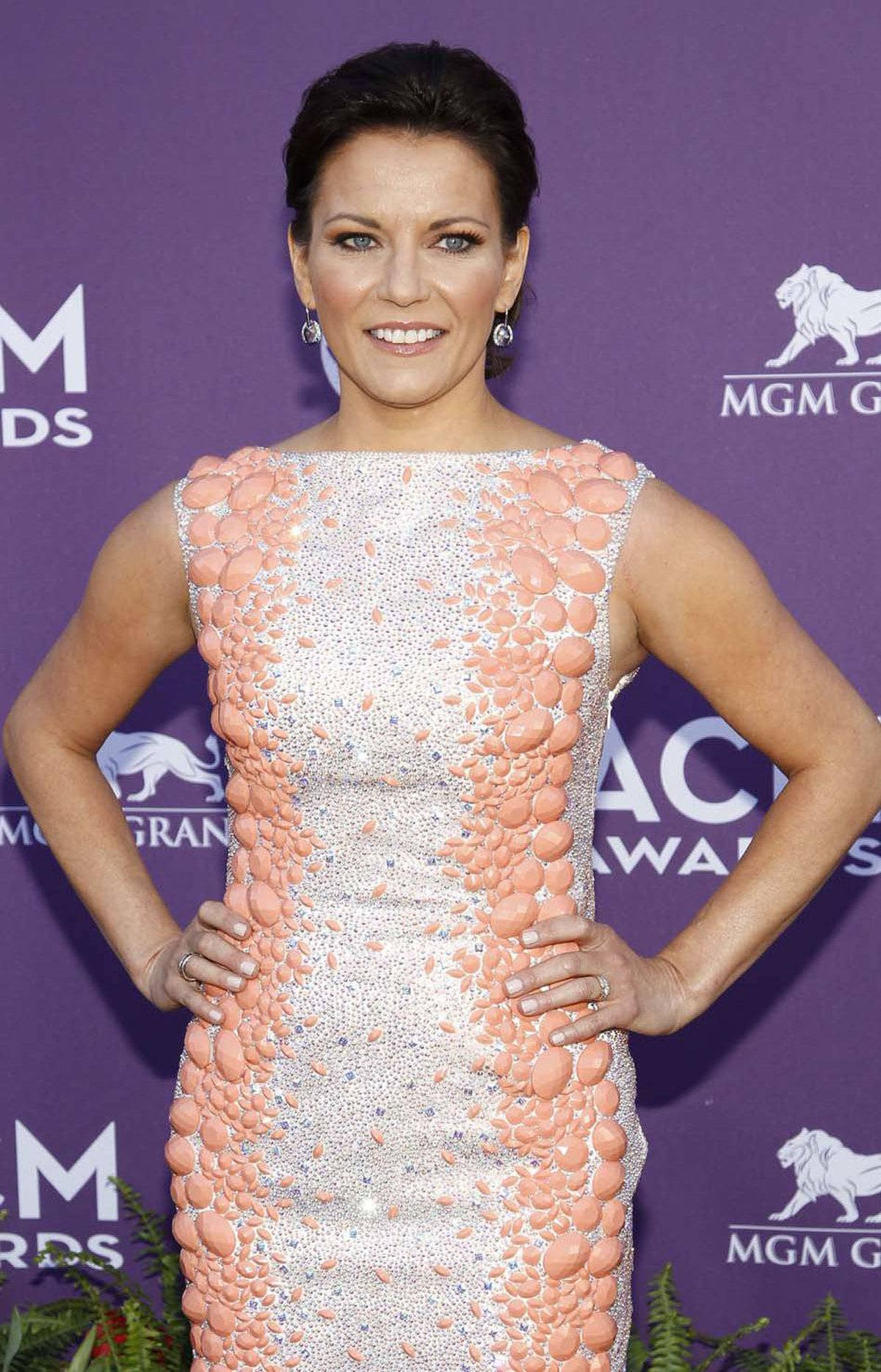 And to think someone almost talked Martina McBride out of wearing salmon-coloured dinosaur scales to the Academy of Country Music Awards in Las Vegas on Sunday. Disaster averted!!