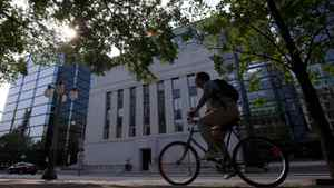 A cyclist passes the Bank of Canada in Ottawa