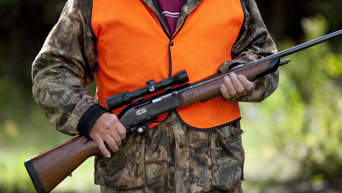 A rifle owner walks around his hunting camp west of Ottawa on Sept. 15, 2010.