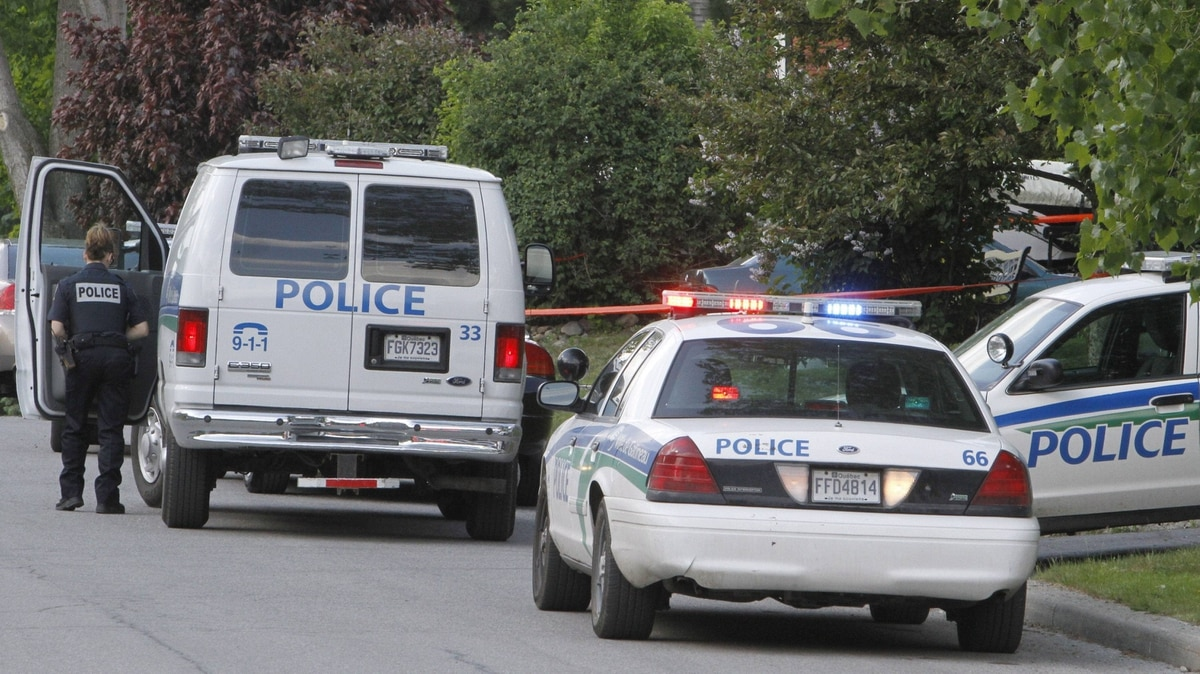 Gatineau Police close off an area around a house where multiple bodies were found on Thursday May 24,2012 in Gatineau, Que.