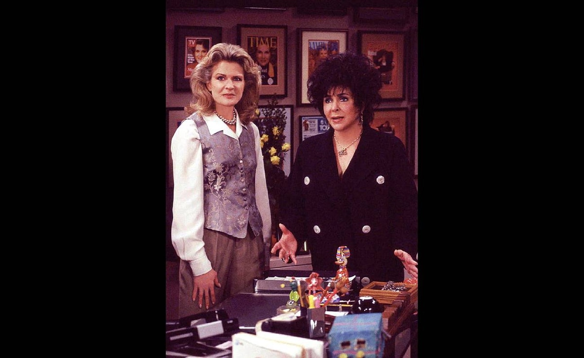 Candice Bergen, left, in character as Murphy Brown, and Elizabeth Taylor are shown in a scene from an episode of Murphy Brown that aired Feb. 26, 1996, on CBS.