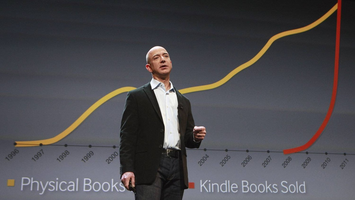 Amazon CEO Jeff Bezos speaks at a news conference in front of a graphic showing the rise in sales of Kindle books during the launch of Amazon's new tablets in New York, in this September 28, 2011.