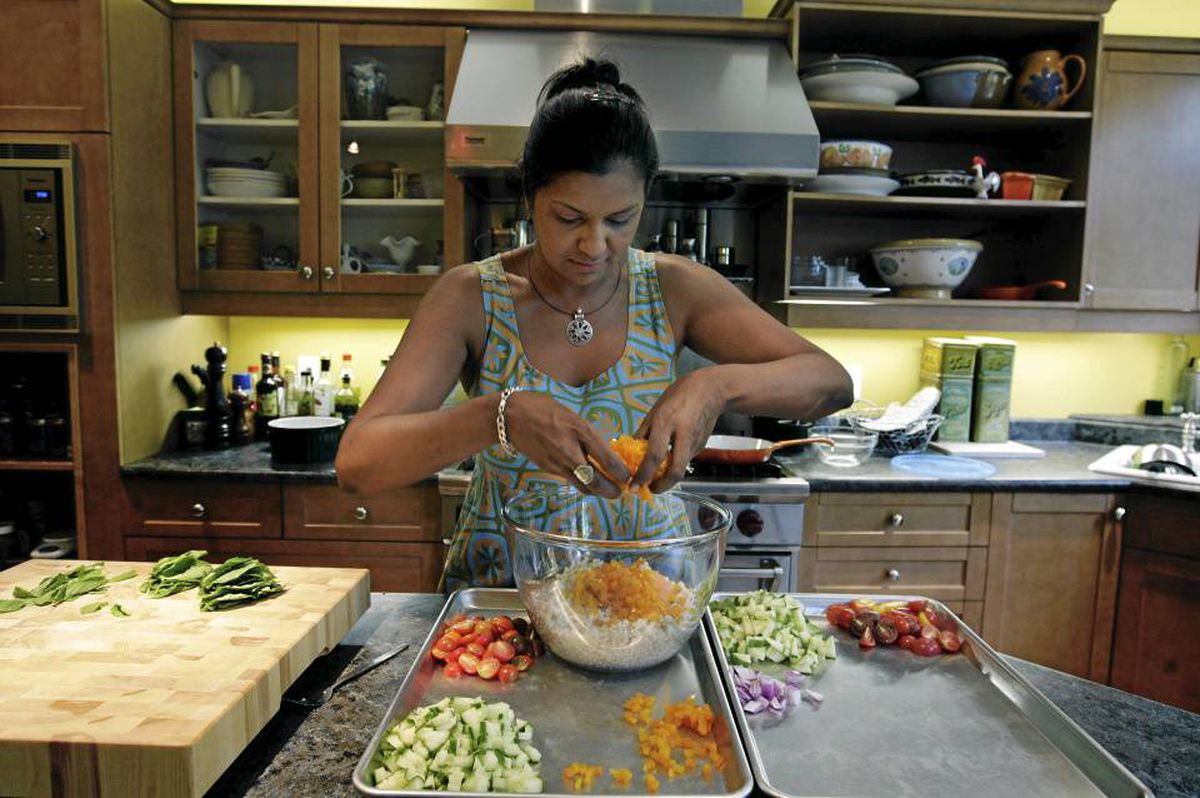 Siva Swaminathan, who teaches healthy nutrition classes to diabetics and is a diabetic herself, prepares gazpacho barley salad with peaches and corn at her home in Toronto. 'I want to demystify food and bring passion back to food for diabetics.'