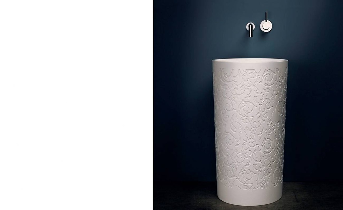 An embossed floral pattern adds interest to a pedestal sink by Vancouver's Blu Bathworks (www.blubathworks.com).