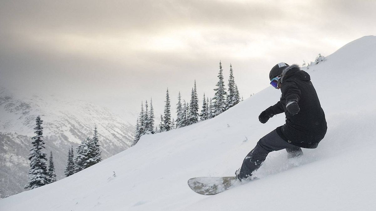 Canadian gold medalist Maelle Ricker carves from a run at Whistler Blackcomb in 2010.