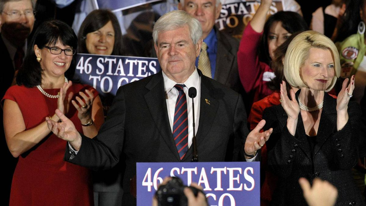 U.S. Republican presidential candidate and former Speaker of the House Newt Gingrich is accompanied by his wife Callista (R) as he addresses supporters at his Florida primary night rally in Orlando, Florida January 31, 2012.