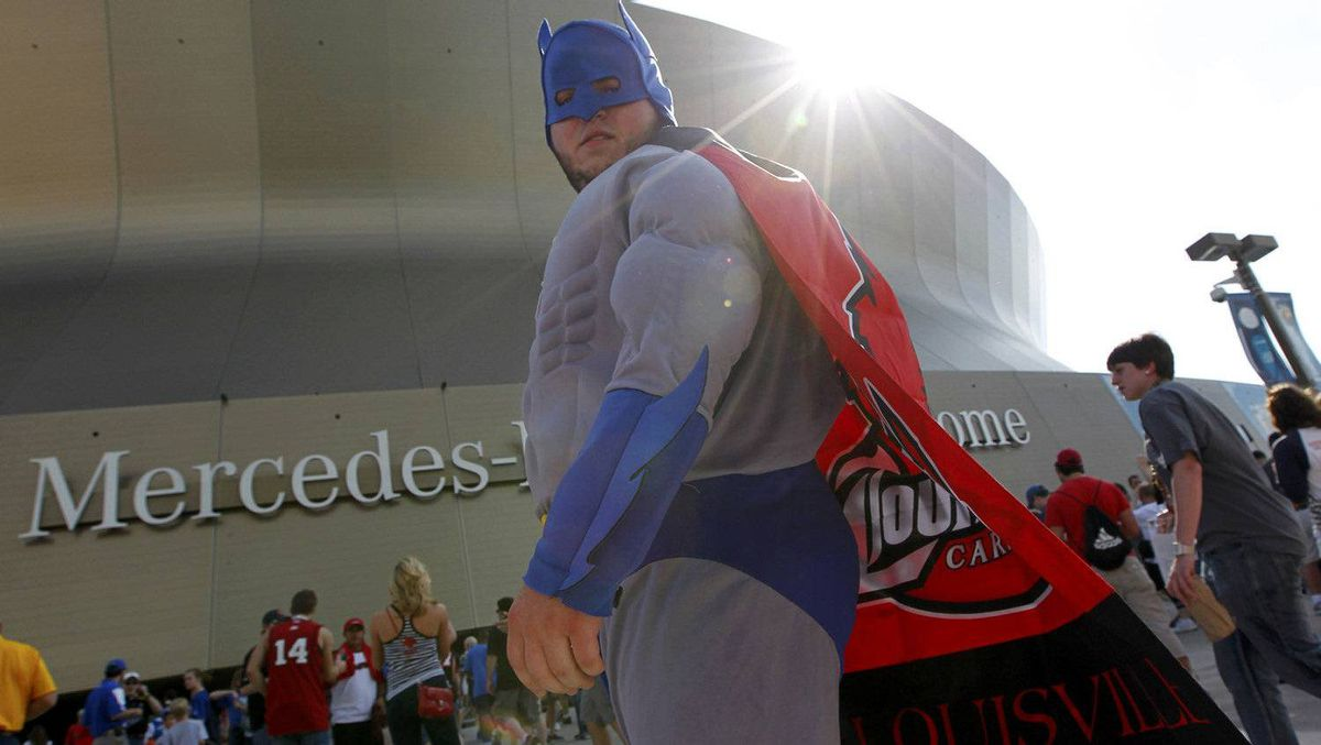 "A Louisville Cardinals fan wears a ""Batman"" costume outside of the venue prior to the men's NCAA Final Four semi-final college basketball games in New Orleans, Louisiana, March 31, 2012. REUTERS/Jonathan Bachman"