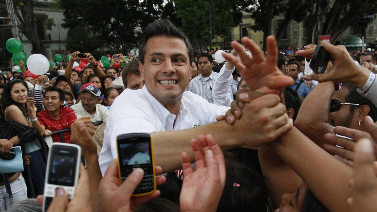 Enrique Pena Nieto, presidential candidate of the opposition Institutional Revolutionary Party (PRI), shakes hands during a political rally in Oaxaca April 10, 2012.