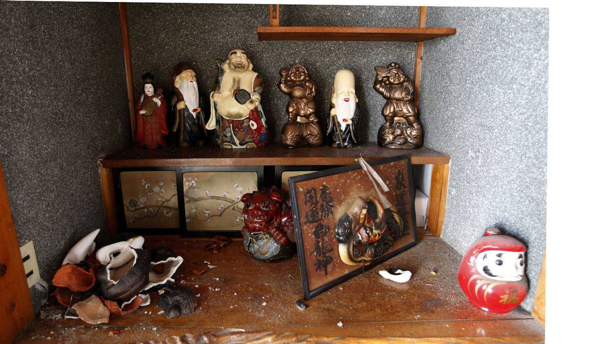 """Dolls of the """"Seven Gods of Good Fortune"""" are seen inside a house that was damaged by an earthquake in Namie town."""