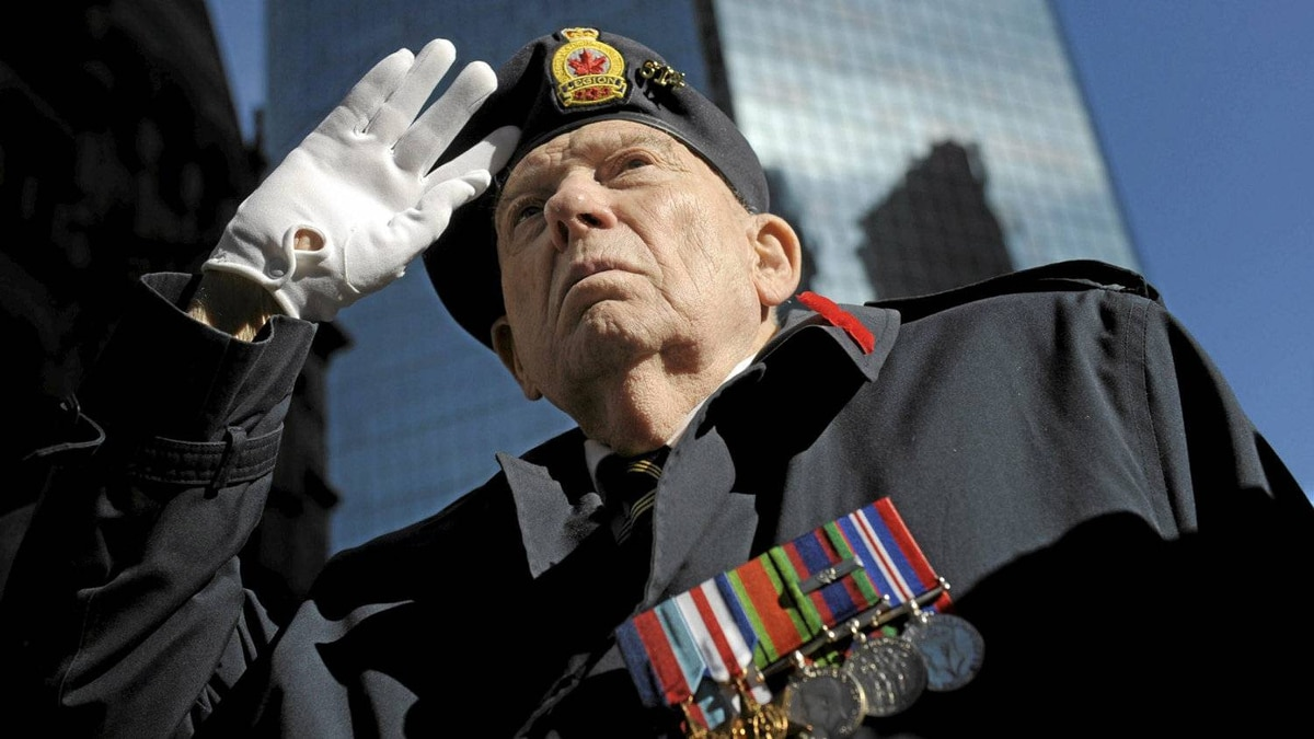 Harold Davis,87, stands at attention as the band played God Save the Queen during Remembrance Day ceremonies at Old City Hall in Toronto on Nov 11 2010. Davis served in the Royal CanadianCorp of Signals from 1939-1945 during the Second World War.