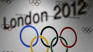 "The name ""London 2012"" is photographed with the Olympic Rings in the background outside the press conference room at the International Olympic Committee (IOC) headquarters on December 10, 2009 in Lausanne. Getty Images/ FABRICE COFFRINI"