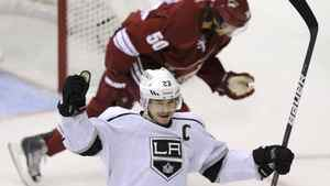 Los Angeles Kings right wing Dustin Brown celebrates teammate Anze Kopitar's 1st period goal against the Phoenix Coyotes as Coyotes' Antoine Vermette (50) skates by during Game 1 of the NHL Western Conference hockey finals in Glendale, Arizona, May 13, 2012. REUTERS/Todd Korol