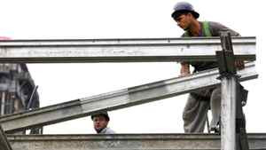 Workers during their daily tasks on a condominium construction site in downtown Toronto, Ontario, Canada.