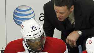 Montreal Canadiens head coach Randy Cunneyworth talks with defenseman P.K. Subban after the Chicago Blackhawks scored a goal in the third period of their NHL hockey game in Chicago, December 21, 2011. Subban said on Monday he was embarrassed by Cunneyworth's move to scratch him from Friday's game in Boston. REUTERS/Frank Polich