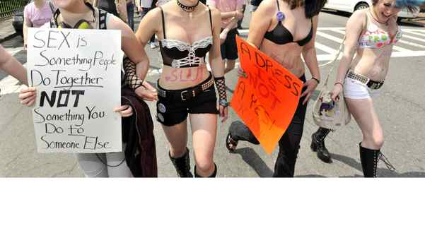 """From left: Isa Stearns of Somerville, Mass., Nadia Friedler of Cambridge, Mass., Louisa Carpenter-Winch, of Cambridge, Mass., and Emma Munson-Blatt, of Cambridge, Mass, march in the """"SlutWalk"""" in Boston on Saturday, May 7, 2011."""