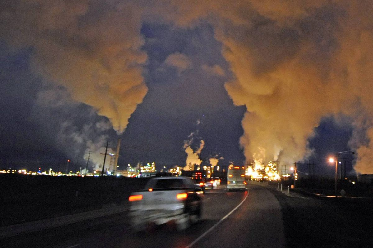 The Syncrude oil sands extraction facility, near Fort McMurray in Alberta, is seen at night on October 22, 2009.