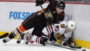 icago Blackhawks right wing Patrick Kane (88) and Anaheim Ducks defenseman Toni Lydman (32) fall to the ice during the first period of an NHL hockey game in Anaheim, Calif., Sunday, Feb. 26, 2012. The Blackhawks are one of several NHL teams to have fallen on hard times writes Eric Duhatschek. (AP Photo/Lori Shepler)
