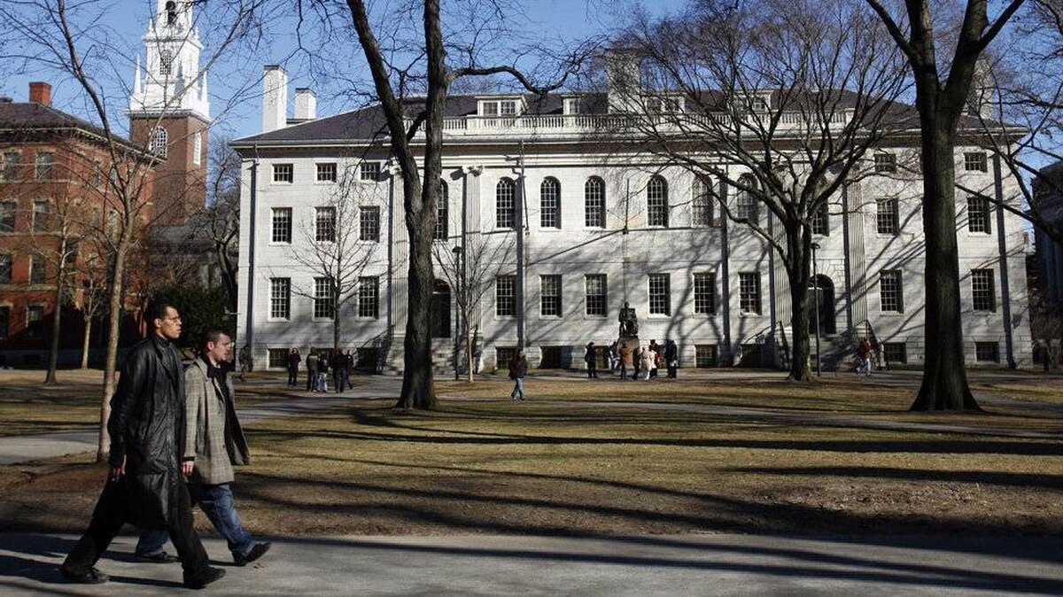 Students walk on the campus of Harvard University in Cambridge, Mass., in February 2008.