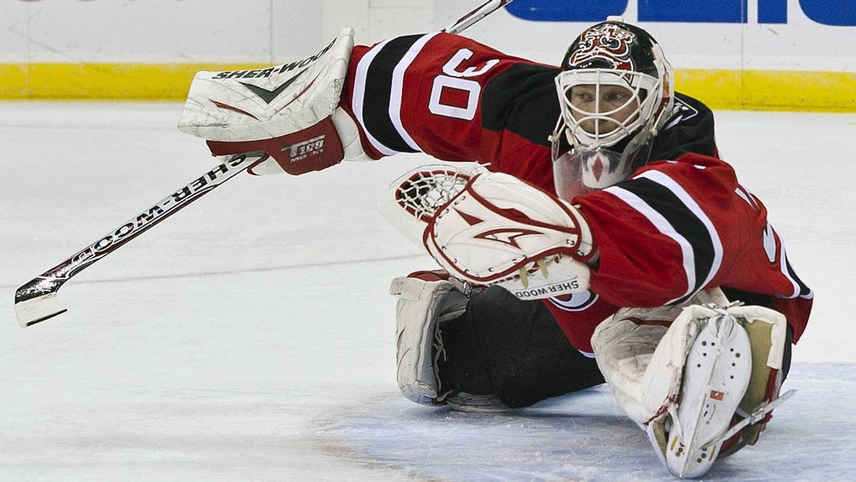 New Jersey Devils goalie Martin Brodeur snares the puck in the web of his glove on an Ottawa Senators shot in the first period of their NHL hockey game in Newark, New Jersey, February 1, 2011.