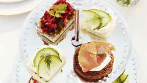 Sandwich island Save space on groaning tabletops by serving sandwiches or sweets on handsome tiered trays.