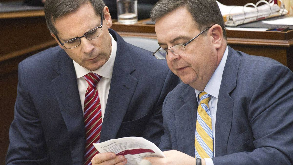 Ontario Premier Dalton McGuinty, left, and Ontario Finance Minister Dwight Duncan, right, study a document before the 2012 provincial budget vote at Queen's Park in Toronto on Tuesday, April 24.