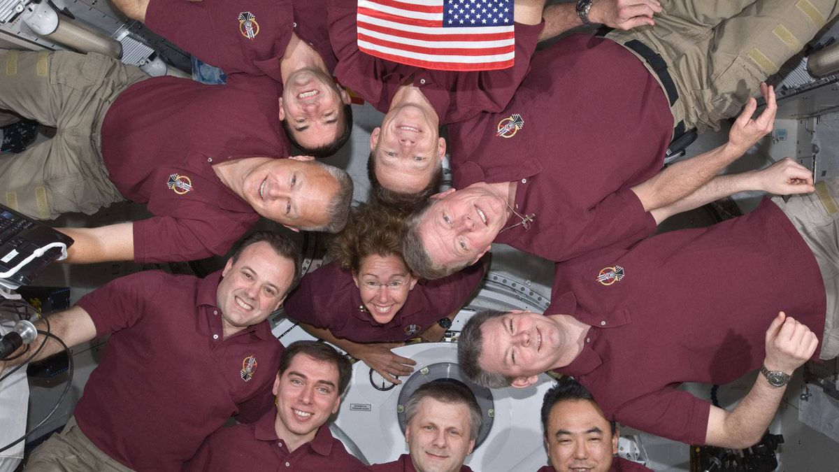 IN SPACE - JULY 15: STS-135 crew consisting of NASA astronauts Chris Ferguson, Doug Hurley, Sandy Magnus and Rex Walheim; the Expedition 28 crewmembers are JAXA astronaut Satoshi Furukawa, NASA astronauts Ron Garan and Mike Fossum, and Russian cosmonauts Andrey Borisenko, Alexander Samokutyaev and Sergei Volkov form a microgravity circle to pose for a portrait aboard the orbiting complex's Kibo laboratory of the Japan Aerospace Exploration Agency on the International Space Station July 15, 2011 in space.