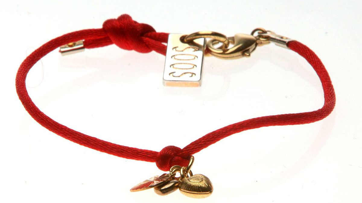 Soos red rope bracelet with charms, $25 through www.soosrocks.com.