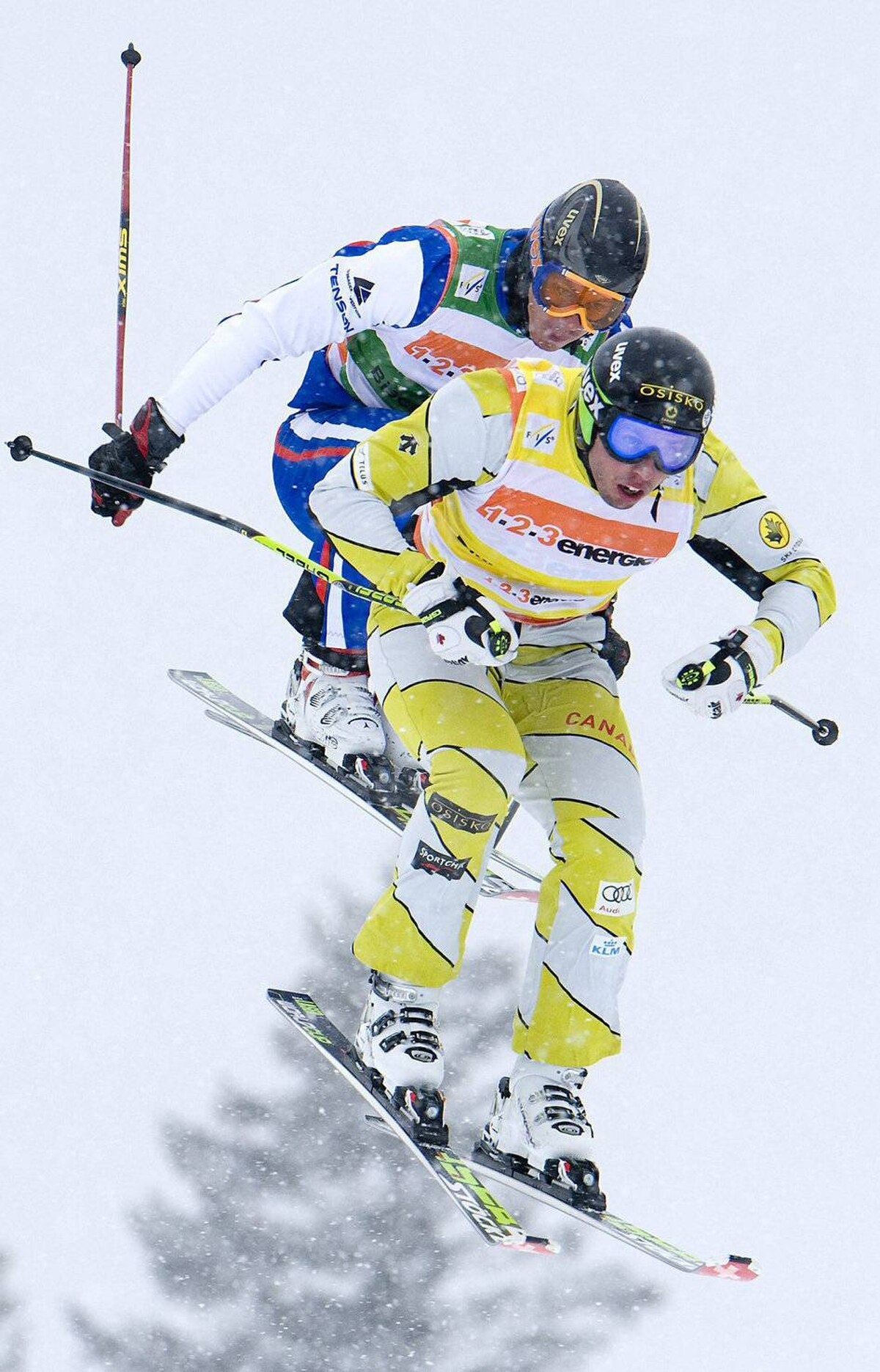 Canada's second placed David Duncan, front, and Russia's Ivan Anikin in action during the men's skicross quarter final at the World Cup ski event in Bischofswiesen, southern Germany , Sunday, Feb. 26, 2012.