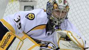 Nashville Predators goalie Pekka Rinne (35), of Finland, makes a glove-save during the third period of Game 3 of an NHL hockey Stanley Cup first-round playoff series against the Detroit Red Wings in Detroit, Sunday, April 15, 2012. (AP Photo/Carlos Osorio)