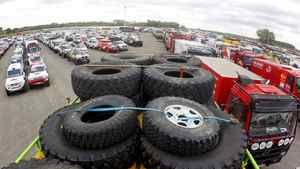Spare tires on top of a truck which will take part in the Dakar 2012 Argentina-Chile-Peru Rally parked at the Zarate docks, 102 km (63 miles) north of Buenos Aires.
