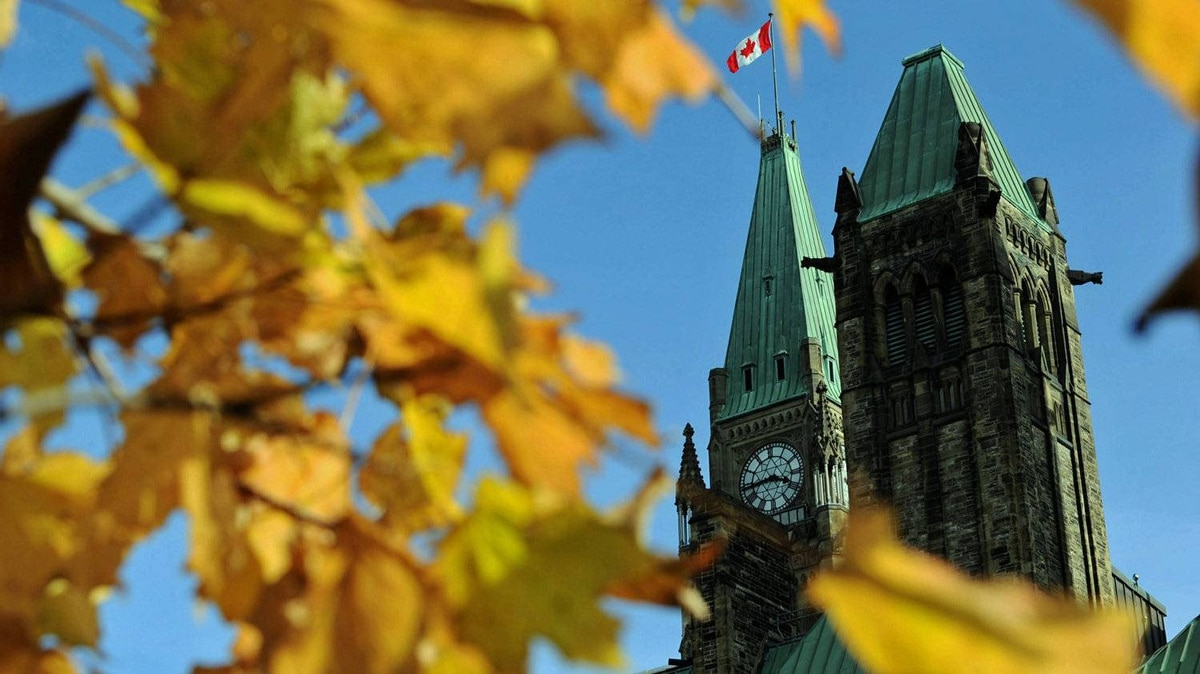 Autumn leaves frame the Peace Tower in Ottawa on Oct. 18, 2011.