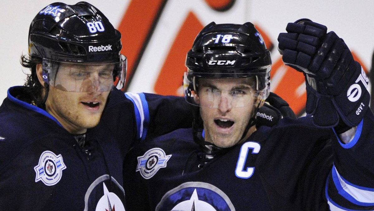 Winnipeg Jets' Andrew Ladd (3rd L) celebrates his second period goal against the Toronto Maple Leafs with teammates Nik Antropov (L) and Kyle Wellwood (not pictured) during their NHL hockey game in Winnipeg December 31, 2011. REUTERS/Fred Greenslade