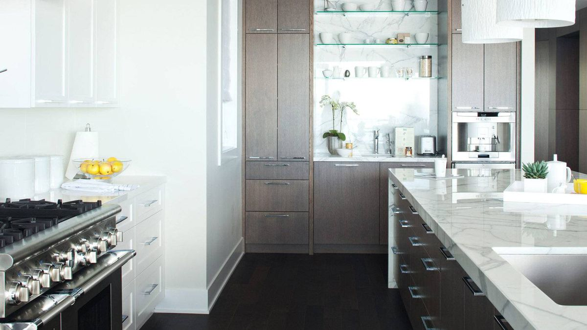 White cabinetry on the back wall blends with the white ceiling giving the kitchen a feeling of openness and invitation.