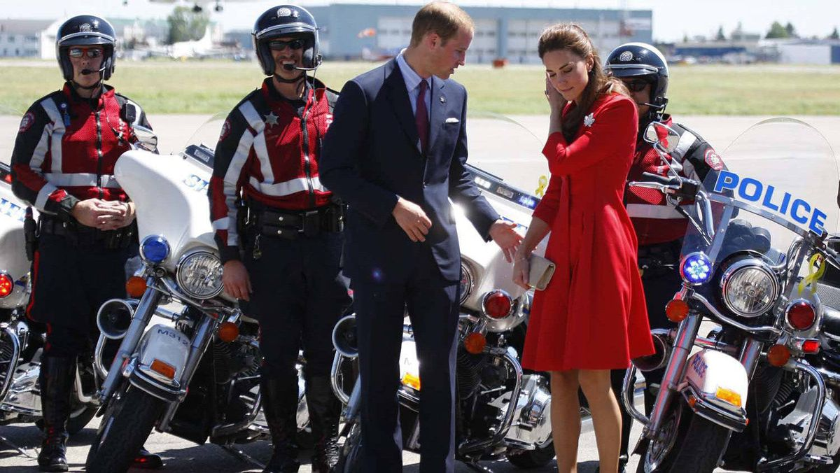 The Duke and Duchess of Cambridge get ready to have their photo taken with their police escort as they get ready to depart Calgary, Friday July 8, 2011.